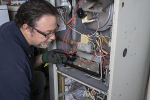 technician-overlooking-gas-furnace