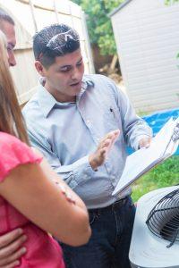 technician-explaining-to-customer