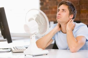 man-with-desk-fan